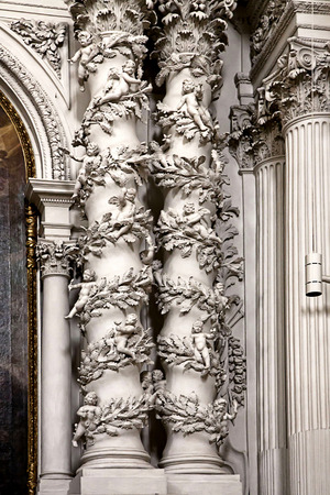 cherubs: Munich, Germany  - Theatine church, baroque white columns of a lateral chapel, decorated by small cherubs and acanthus leaves Stock Photo