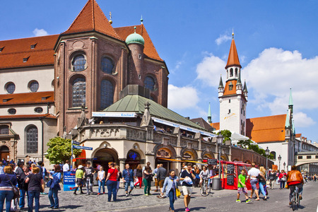 st peter: Munich Germany - people shop in center city with the view of St. Peter church apse and old city hall tower