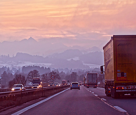 drive safely: Salzburg, Austria- High traffic as usual on the highway to Munich in a cold winter sunset with snow covering the mountains Editorial