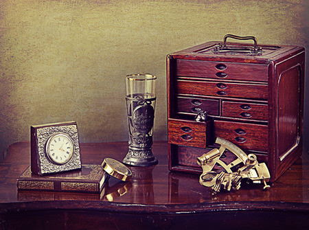 pewter: Vintage still life, jewelry wooden box, clock, antique book, sextant and pewter and glass goblet