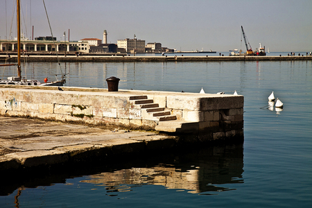 rive: Trieste, Italy - it is a quiet morning , ideal weather for a walk on the Trieste waterfront, called Le Rive,  with the view of Molo Audace pier