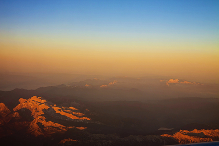 mountaintops: spectacular mountain aerial view from the flight Trieste-Munich at sunset