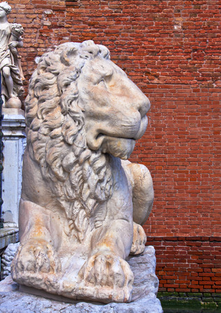 prowess: Venice, Italy - marble lion, symbol of the city, outside Arsenal entrance