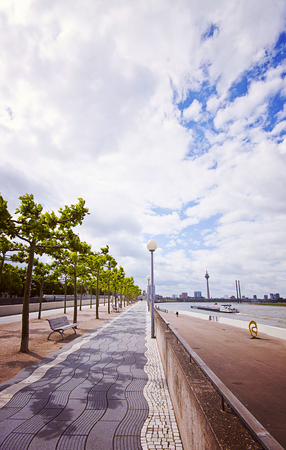 fluvial: Dusseldorf, Germany  - promenade along the Rhine river, with view of the fluvial traffic, the city and the Rhine tower Stock Photo