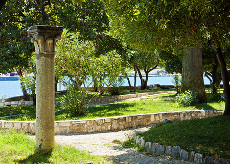 green park: Trogir, Croatia - public green park offers a  refreshing shadow on summer days in front of the sea