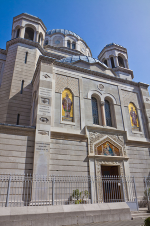surmounted: Trieste, Italy - Saint Spyridon Church, cathedral of Serbian Orthodox community in Trieste, rich facade with golden mosaics surmounted by domes Editorial