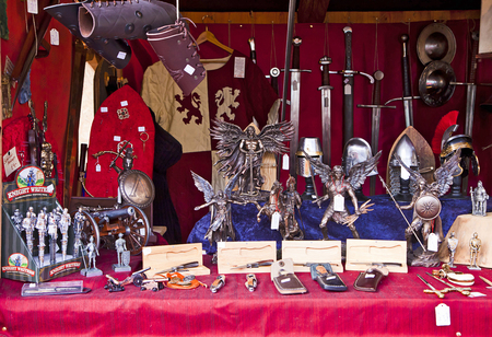 souvenir traditional: Munich, Germany -Stall at traditional Medieval Christmas market  Mittelaltermarkt at Wittelsbacher Platz in Munich.On sell medieval stuff, cutting weapon, metal figurines and souvenir Editorial