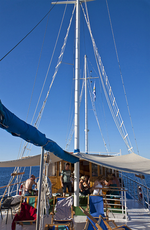 leisurely: CROATIA, DALMATIAN COAST - AUGUST 18,2014. Tourists navigate leisurely on an old-fashioned cruise ship on a sunny summer day Editorial