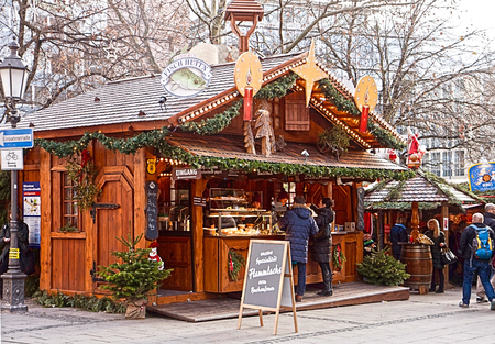 christkindlmarkt: Munich, Germany - People halt at a fish fast food stall for a quick snack in one of the many Christmas markets in town