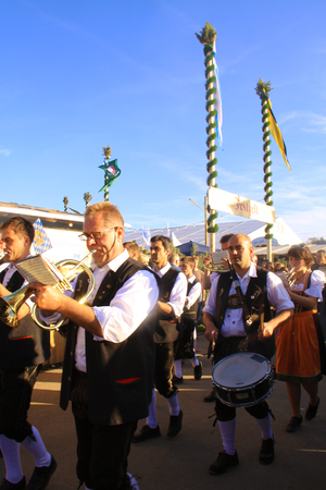 traditional culture: Band in Bavarian traditional costume is performing outside at Oktoberfest in Munich. Since 1810 Oktobefest, the beer festival,  is part of Bavarian culture. It delights million of visitors with excellent beer,Bavarian food and traditional music.