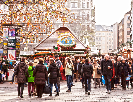 shopping scene: Munich, Germany - Christmas time: people stroll looking for presents at one of the many Christmas market in town