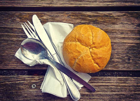 grunge cutlery: White bread, cutlery and table napkin on grunge wooden bench