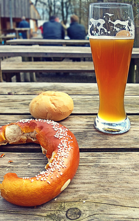 Relax at beer garden, Bavarian beer and pretzel.More than of food, beer and pretzel are the symbol of Bavarian way of life,a moment shared with friends in a beer garden or at Oktoberfest