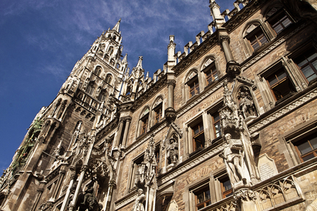 gothic style: Munich, Germany -detail of the beautiful architecture in Gothic style of the City Hall (Rathaus) with the clock tower  in Marienplatz