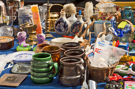 home related: Used and vintage home related stuff on display at flea market: ceramics,mugs,toys,bottles, decorations Editorial