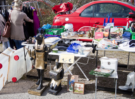 used clothes: Eching, Germany - bargains, Anubi statue, Egyptian art,books,used clothes  at the first spring open air flea market of the season in a quiet rural corner