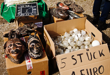 bargains: Bargains at open air flea market; exotic wooden mask, wall clock and light bulbs