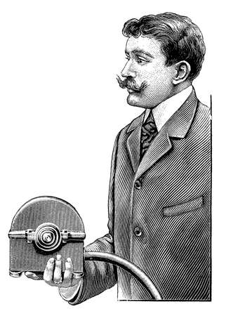 handlebar: Gemtleman well dressed with handlebar moustache - maybe an inventor - presents a small hydraulic turbine