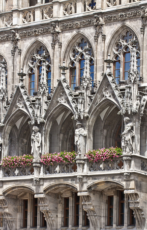 gothic revival: Munich Germany - detail of the facade of the new City Hall in Marienplatz richly decorated in Gothic Revival architecture Editorial