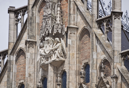 gothic revival: Munich Germany - detail of the facade front piece of the new City Hall in Marienplatz richly decorated in Gothic Revival architecture