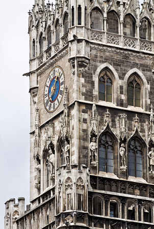 gothic revival: Munich, Germany, close up view of the clock tower of the New Town Hall in Marienplatz, richly decorated in Gothic Revival architecture