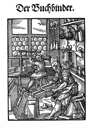 XVI century -  bookbinding shop Stock Photo