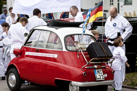 old glory: Garching, Germany, to old glory vintage car BMW Isetta 300 at the gathering before the beginning of the traditional parade in Garching, universitary town few kilometers North of Munich Editorial