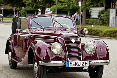 gdr: GARCHING, GERMANY, vintagecars at Garching traditional parade: red shiny old IFA 2 door hatchback, produced in GDR in the years 1949 to 1956