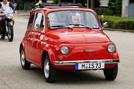 GARCHING, GERMANY, vintagecars at Garching traditional parade: an Italian Classic red Fiat 500