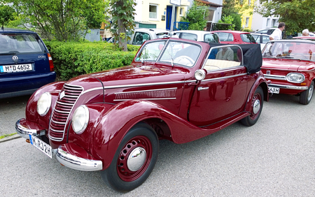 GARCHING, GERMANY, Vintage cars at Garching traditional parade: red shiny old IFA 2 door cabriolet, produced in East Germany in the years 1949 to 1956