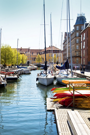 Copenhagen, Denmark: view of Christianshavn from one of the sea channels crossing the quarter: ancient neighbourhood once a merchant town then incorporated in Copenhagen and part of Copenhagen harbor