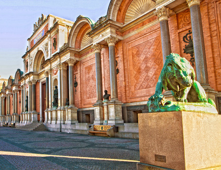 carlsberg: Copenhagen, Denmark, Ny Carlsberg Glyptotek facade and entrance with the bronze statue of lion fighting a snake.  The art museum was inaugurated in 1906.