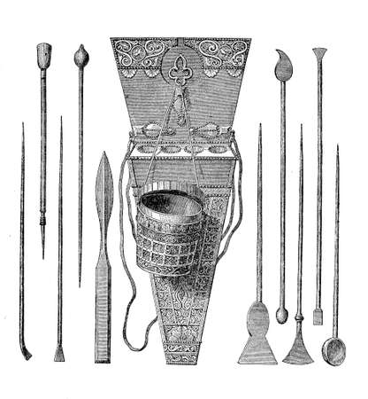 inkpot: Ancient Roman decorated writing set: inkpot and many iron styluses, pointed instruments of different shapes