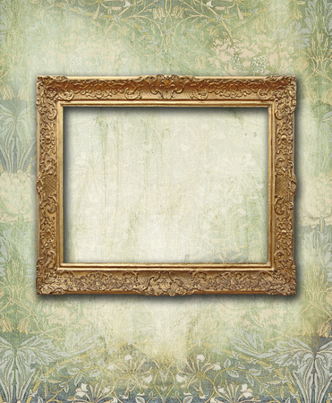 victorian wallpaper: Empty golden frame on Victorian floral green and gold wallpaper