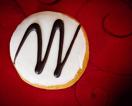 Doughnut with glazed cream and chocolate decoration Stock Photo - 72831123