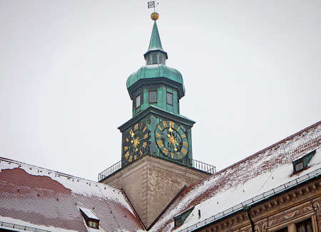 residenz: Munich, Germany - Winter view of the gothic clock tower of the Residenz, royal palace of the former Bavarian kings, in Renaissance Italian style