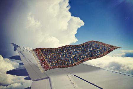 surrealistic flying carpet flies over an airplane in the blue sky. Partial 3D rendering Stock Photo - 73065682