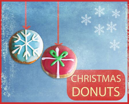 christmas cake: Doughnuts with glazed cream and Christmas decorations, placard  with grunge old-fashioned effects