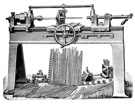 machining: Metalworking, turning bench lathe in production with accessories, vintage engraving