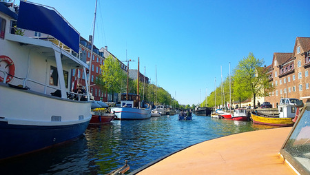 Copenhagen, Denmark: view from a motor boat ofthe main channel crossing Christianshavn:  once merchant town then incorporated in Copenhagen and part of the city harbor