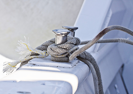fixed line: Sailboat detail, metal cleats with rope turned around
