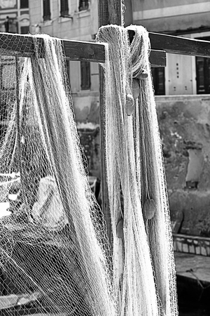 fishing nets sprawled out to dry in the sun in the harbor of Camogli, Italy, village fisher on the Ligurian coast Stock Photo