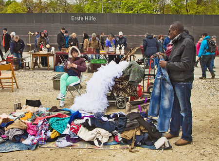 antique booth: Munich, casual used wear but also a wedding dress on sell at the open air giant flea market,the biggest flea market of Bavaria, more than 2000 market stalls just for one day in spring. You find everything, very cheap. Editorial