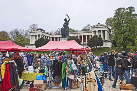 antique booth: Munich, Germany -View of the open air giant flea market,the biggest flea market of Bavaria, more than 2000 market stalls just for one day in spring. You find everything, very cheap.
