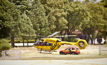 ADAC helicopter departing from a wheat field after a call for an emergency doctor.