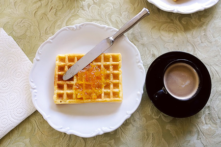 waffle with orange marmalade and espresso coffee for a quick breakfast Stock Photo