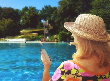blonde woman looking at her cellphone in holiday