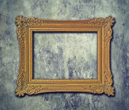 empty golden baroque frame on grunge wall stock photo picture and