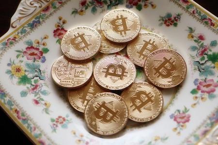 heap of shiny bitcoins close up