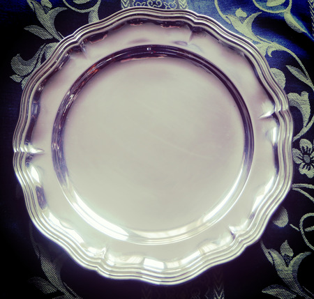 Beautiful shiny silver plate in classical style